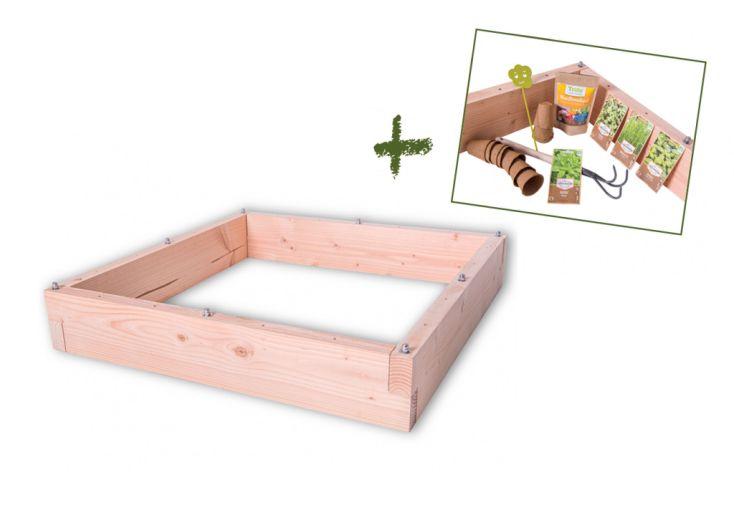 jardinière en bois avec aromates et outils