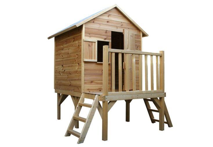 Cabane en bois brut montée sur pilotis avec 2 échelles