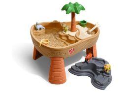table d'activités jeux d'eau et de sable île préhistorique avec dinosaures